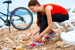 Woman with bicycle on the beach Royalty Free Stock Photos