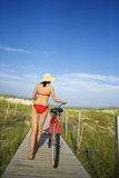 Woman with Bicycle on Boardwalk Royalty Free Stock Images