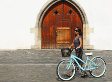 Woman With A Bicycle In A City Royalty Free Stock Photos