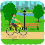 Woman on Bicycle on City street. Cyclist in the city. Flat  illustration. Royalty Free Stock Photos