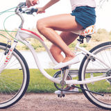 Woman on bicycle. Royalty Free Stock Image