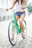 Woman on bicycle Stock Images