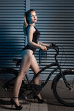 Woman with a bicycle cruiser. Royalty Free Stock Photos
