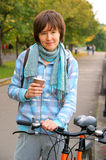 Woman with bicycle with cup and bicycle Royalty Free Stock Photo