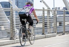 Shapely woman exercising in cycling driving along the bike path of Tilikum Crossing Bridge preferring active healthy lifestyle