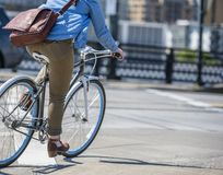 Woman rushes on bike on the city street friendly for lovers of bikes