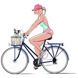 Woman on a bicycle with a dog Royalty Free Stock Photography