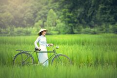 Woman With Bicycle on Grass Stock Photo