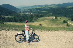 Woman on a bicycle in mountains Royalty Free Stock Photography