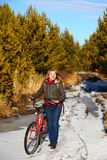 Woman with bicycle on nature Royalty Free Stock Photos