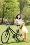 Woman with a bicycle in nature Stock Image