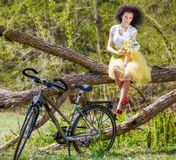 Woman with a bicycle in nature Royalty Free Stock Images
