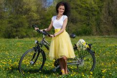 Woman with a bicycle in nature Royalty Free Stock Photo