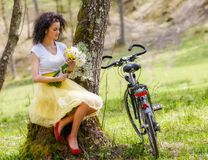 Woman with a bicycle in nature Royalty Free Stock Photography
