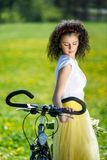 Woman with a bicycle in nature Royalty Free Stock Image