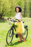 Woman with a bicycle in nature Stock Images
