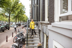 Woman with bicycle near the house entrance Stock Photo