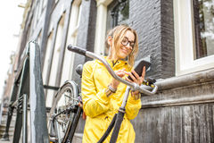 Woman with bicycle near the house entrance Royalty Free Stock Photos