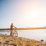 Woman on a bicycle near the water Stock Image