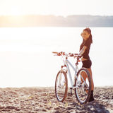 Woman on a bicycle near the water Stock Photography