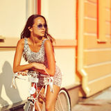 Woman with bicycle outdoor fashion portrait Royalty Free Stock Photos