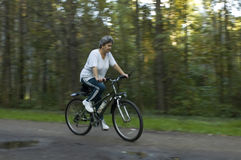 Woman on bicycle in park Royalty Free Stock Photography