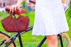 Woman with bicycle in a park stock photos
