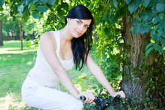 Woman on a bicycle in the park Stock Photo