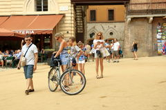 Woman with bicycle on Piazza del Campo in Siena, Italy Stock Photo