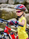 Woman on bicycle ride mountain. Girl traveling in summer park. Stock Image