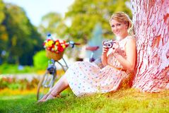 Woman after bicycle ride relaxing with camera Stock Photos
