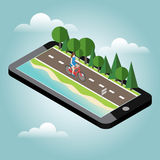 Woman on bicycle on the road near the beach and forest Royalty Free Stock Photos