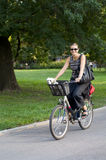 Woman on bicycle smiling. Royalty Free Stock Image