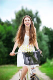 Woman on bicycle smiling Stock Photo