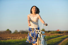 Woman with Bicycle Stock Image