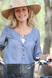 Woman on a bicycle Stock Images
