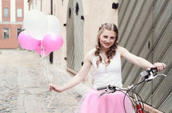 Woman with bicycle Royalty Free Stock Images