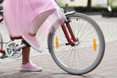 Woman with bicycle Stock Photography