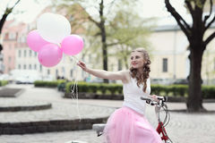 Woman with bicycle Royalty Free Stock Photo