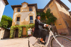 Woman on a bicycle through the streets of the country Royalty Free Stock Image