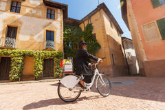Woman on a bicycle through the streets of the country Royalty Free Stock Photos