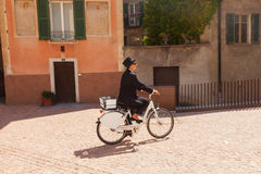 Woman on a bicycle through the streets of the country Royalty Free Stock Images