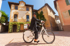 Woman on a bicycle through the streets of the country Stock Photo