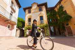 Woman on a bicycle through the streets of the country Royalty Free Stock Photography