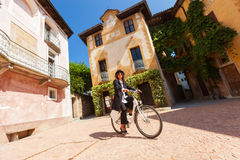 Woman on a bicycle through the streets of the country Stock Image