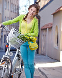 Woman with a bicycle on the streets of old Paris Stock Photos