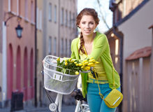Woman with a bicycle on the streets of old Paris Stock Photo