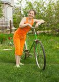 Woman  with bicycle in  summer Stock Photo