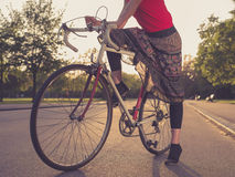 Woman on bicycle at sunset Royalty Free Stock Images