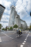 Woman on a bicycle with tall office buildings in the background Royalty Free Stock Image
